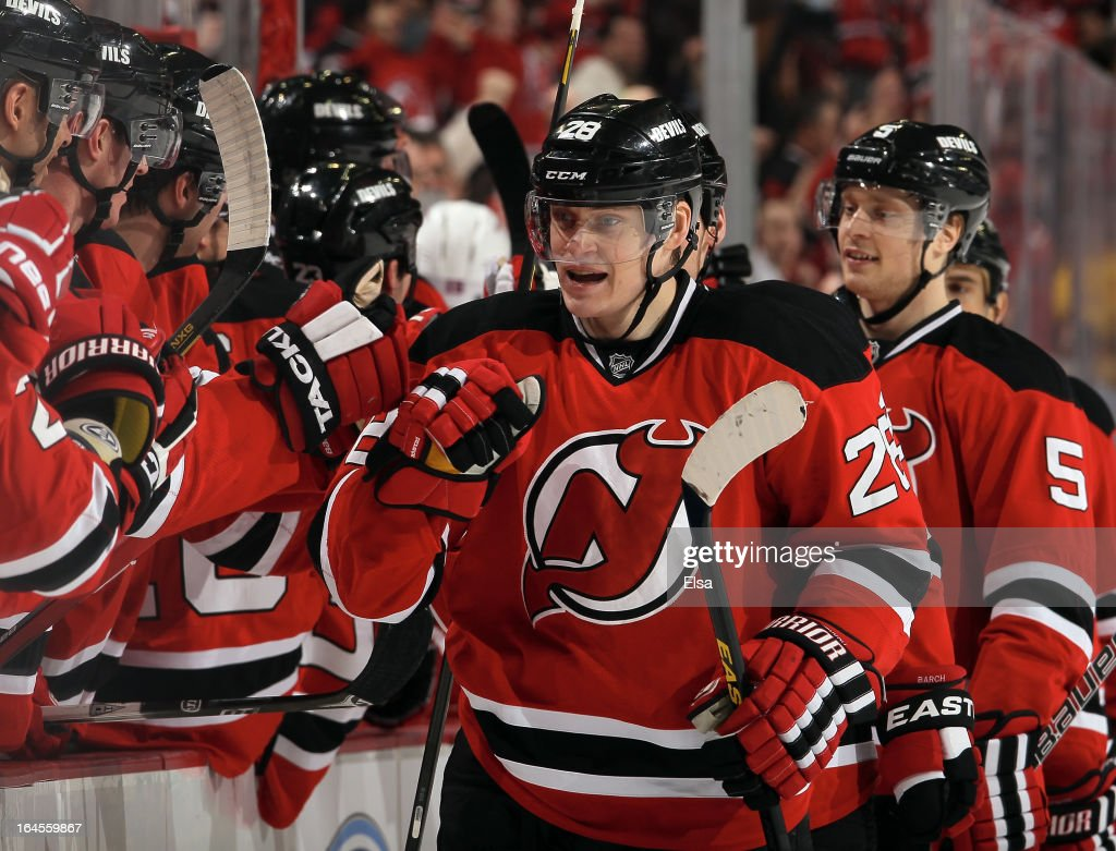 Anton Volchenkov #28 of the New Jersey Devils celebrates his goal with teammates on the bench in the first period against the New York Rangers at the Prudential Center on March 19, 2013 in Newark, New Jersey.
