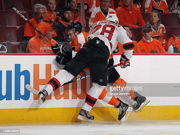 Anton Volchenkov of the New Jersey Devils hits Matt Read of the Philadelphia Flyers into the boards in Game Two of the Eastern Conference Semifinals...