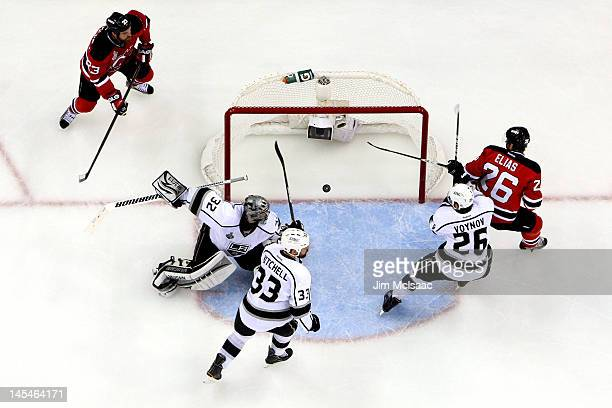 Anton Volchenkov of the New Jersey Devils scores a goal in the second period against Jonathan Quick of the Los Angeles Kings as David Clarkson Willie...