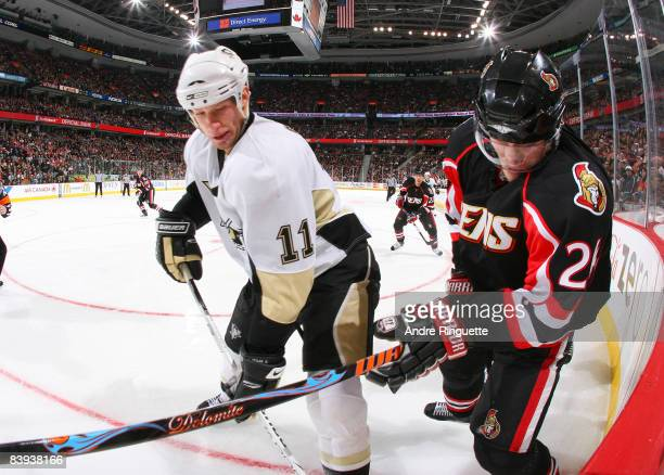 Anton Volchenkov of the Ottawa Senators battles along the boards with Jordan Staal of the Pittsburgh Penguins at Scotiabank Place on December 6, 2008...