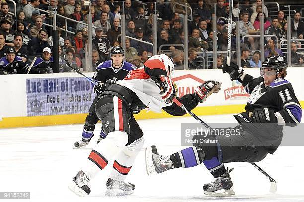 Anton Volchenkov of the Ottawa Senators collides with Anze Kopitar of the Los Angeles Kings during the game on December 3, 2009 at Staples Center in...