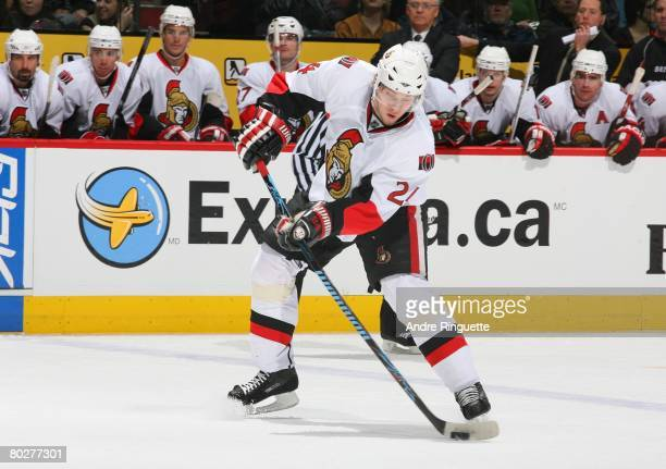 Anton Volchenkov of the Ottawa Senators shoots the puck against the Montreal Canadiens at the Bell Centre on March 13, 2008 in Montreal, Quebec,...