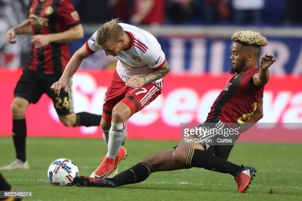 Anton Walkes of Atlanta United tackles Daniel Royer of New York Red Bulls during the New York Red Bulls Vs Atlanta United FC MLS regular season match...