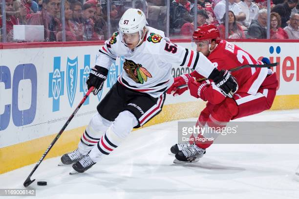 Anton Wedin of the Chicago Blackhawks skates with the puck behind the net followed by Patrik Nemeth of the Detroit Red Wings during a pre-season NHL...
