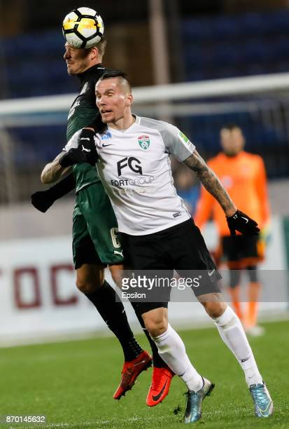 Anton Zabolotny of FC Tosno and Andreas Granqvist of FC Krasnodar vie for a header during the Russian Football League match between FC Tosno and FC...