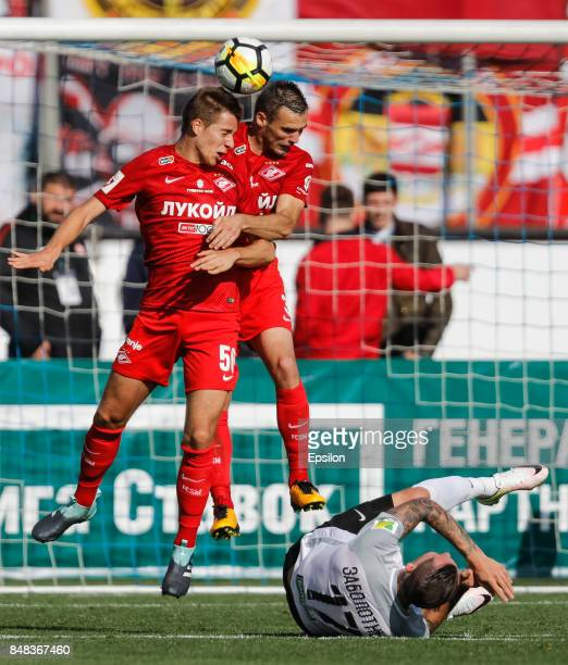 Anton Zabolotny of FC Tosno Mario Pasalic of FC Spartak Moscow and Marko Petkovic of FC Spartak Moscow in action during the Russian Football League...