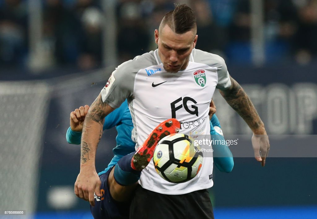 Anton Zabolotny of FC Tosno vie for the ball during the Russian Football League match between FC Zenit Saint Petersburg and FC Tosno at Saint Petersburg Stadium on November 19, 2017 in St. Petersburg, Russia.