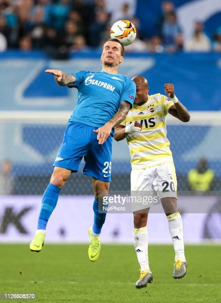 Anton Zabolotny of FC Zenit Saint Petersburg and Andre Ayew of Fenerbahce SK vie for the ball during the UEFA Europa League round of 32 match between...