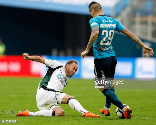 Anton Zabolotny of FC Zenit Saint Petersburg and Andreas Granqvist of FC Krasnodar vie for the ball during the Russian Football League match between...
