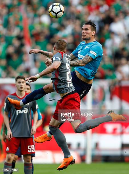 Anton Zabolotny of FC Zenit Saint Petersburg and Dmitri Tarasov of FC Lokomotiv Moscow during the Russian Football League match between FC Lokomotiv...