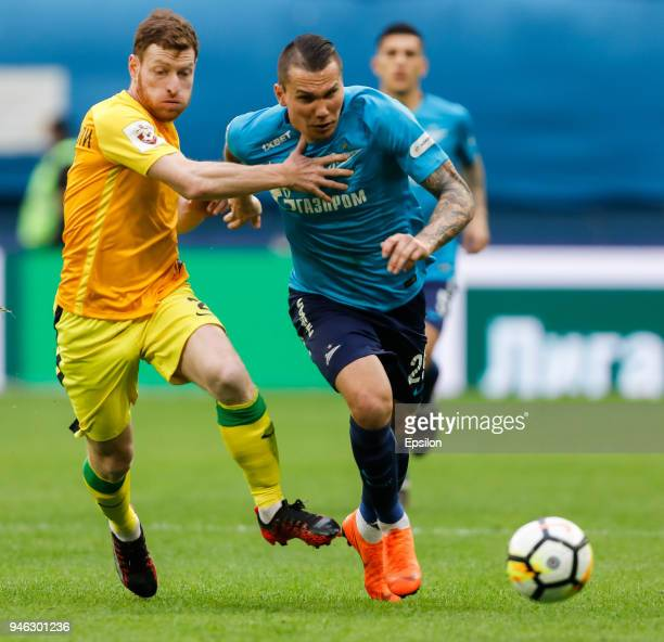 Anton Zabolotny of FC Zenit Saint Petersburg and Guram Tetrashvili of FC Anji Makhachkala vie for the ball during the Russian Football League match...