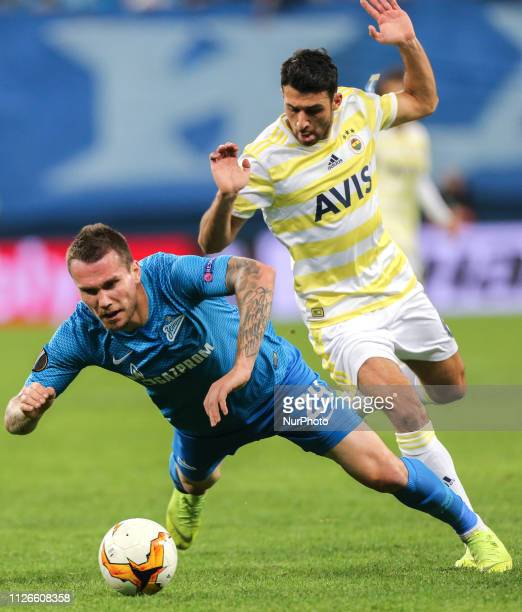 Anton Zabolotny of FC Zenit Saint Petersburg and Ismail Koyba of Fenerbahce SK vie for the ball during the UEFA Europa League round of 32 match...