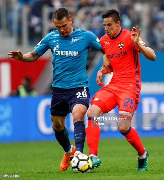 Anton Zabolotny of FC Zenit Saint Petersburg and Kristijan Bistrovic of PFC CSKA Moscow vie for the ball during the Russian Football League match...