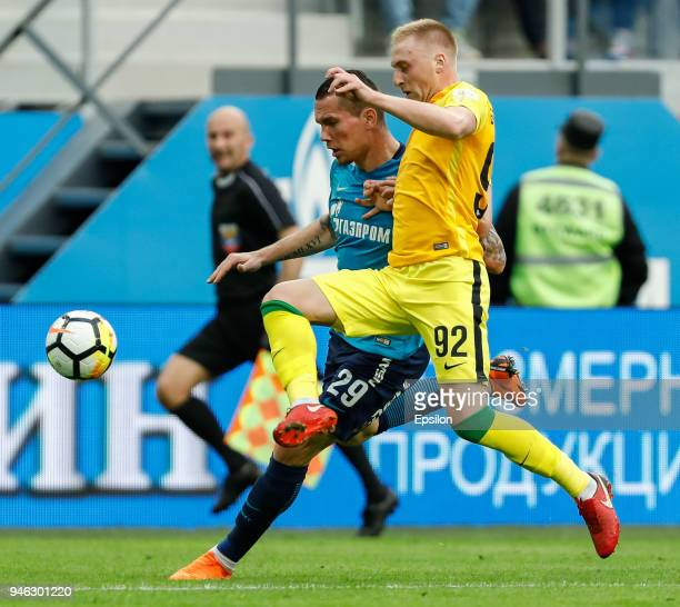 Anton Zabolotny of FC Zenit Saint Petersburg and Sergei Bryzgalov of FC Anji Makhachkala vie for the ball during the Russian Football League match...