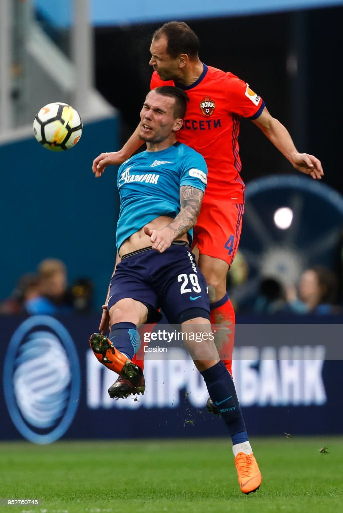 Anton Zabolotny (L) of FC Zenit Saint Petersburg and Sergei Ignashevich of PFC CSKA Moscow vie for the ball during the Russian Football League match between FC Zenit Saint Petersburg and PFC CSKA Moscow on April 29, 2018 at Saint Petersburg Stadium in Saint Petersburg, Russia.