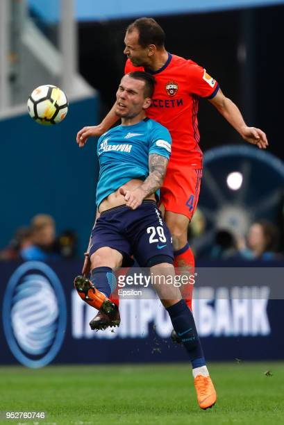 Anton Zabolotny of FC Zenit Saint Petersburg and Sergei Ignashevich of PFC CSKA Moscow vie for the ball during the Russian Football League match...
