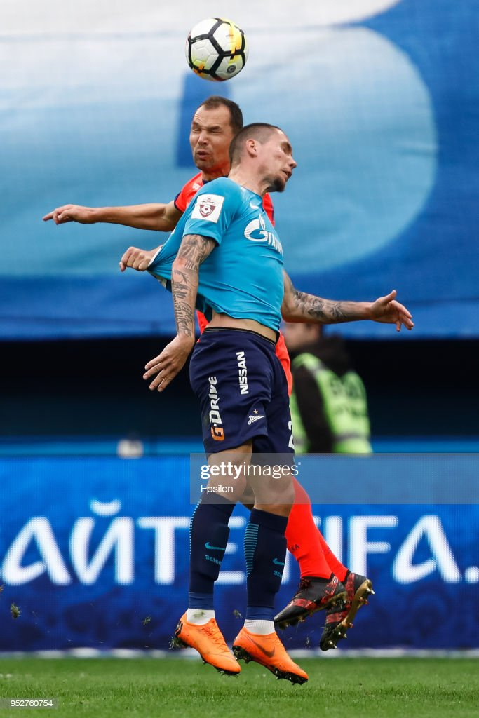 Anton Zabolotny (R) of FC Zenit Saint Petersburg and Sergei Ignashevich of PFC CSKA Moscow vie for a header during the Russian Football League match between FC Zenit Saint Petersburg and PFC CSKA Moscow on April 29, 2018 at Saint Petersburg Stadium in Saint Petersburg, Russia.