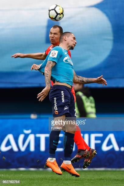Anton Zabolotny of FC Zenit Saint Petersburg and Sergei Ignashevich of PFC CSKA Moscow vie for a header during the Russian Football League match...