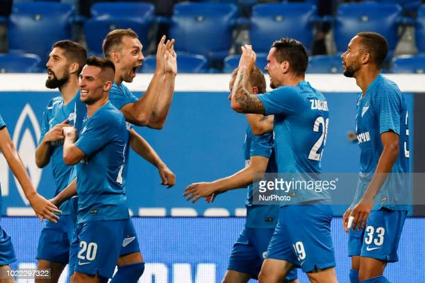Anton Zabolotny of FC Zenit Saint Petersburg celebrates his goal with teammates during the UEFA Europa League playoffs first leg match between FC...