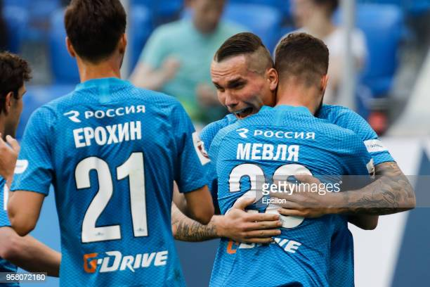 Anton Zabolotny of FC Zenit Saint Petersburg celebrates his goal with teammates during the Russian Football League match between FC Zenit Saint...