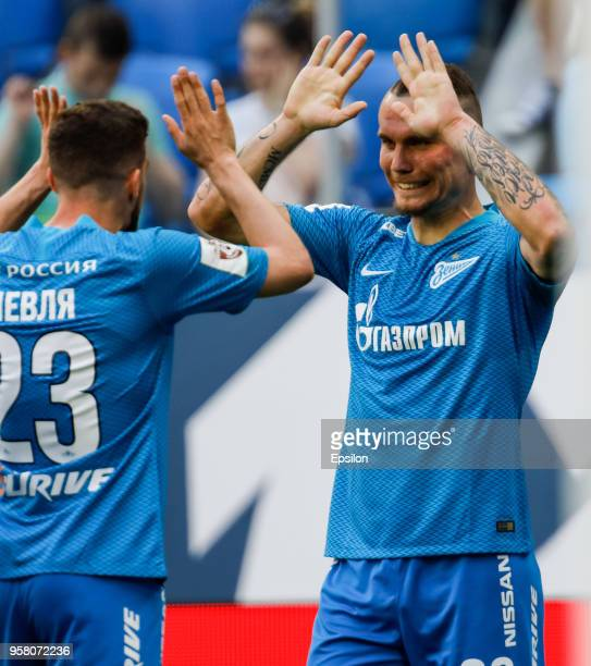 Anton Zabolotny of FC Zenit Saint Petersburg celebrates his goal with Miha Mevlja during the Russian Football League match between FC Zenit Saint...