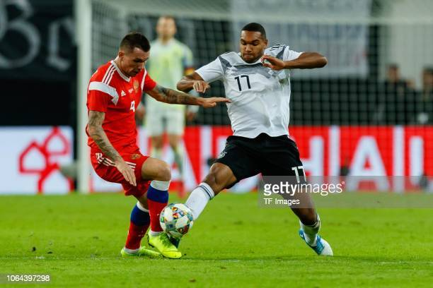 Anton Zabolotny of Russia and Jonathan Tah of Germany battle for the ball during the International Friendly match between Germany and Russia at Red...