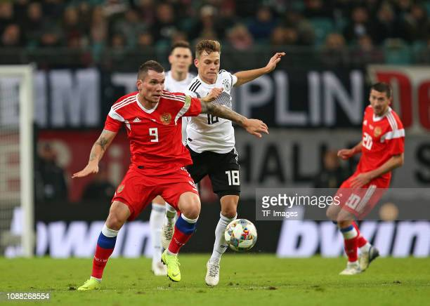 Anton Zabolotny of Russia and Joshua Kimmich of Germany battle for the ball during the International Friendly match between Germany and Russia at Red...