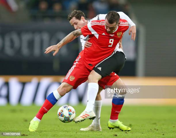 Anton Zabolotny of Russia and Sebastian Rudy of Germany battle for the ball during the International Friendly match between Germany and Russia at Red...