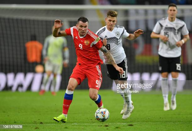 Anton Zabolotny of Russia is challenged by Joshua Kimmich of Germany during the International Friendly match between Germany and Russia at Red Bull...