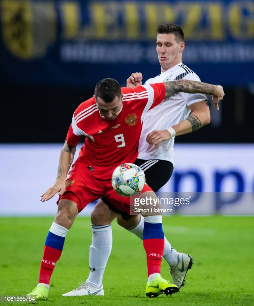 Anton Zabolotny of Russia is challenged by Niklas Suele of Germany during the International Friendly match between Germany and Russia at Red Bull...