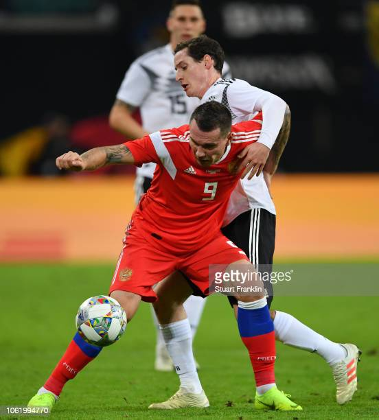 Anton Zabolotny of Russia is challenged by Sebastian Rudy of Germany during the International Friendly match between Germany and Russia at Red Bull...