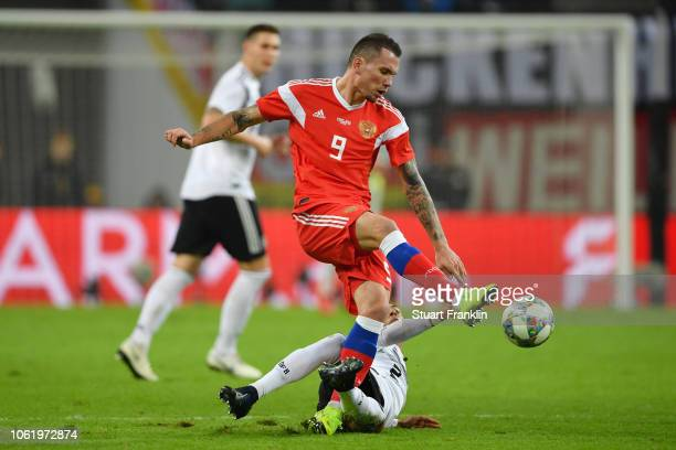 Anton Zabolotny of Russia is challenged by Thilo Kehrer of Germany during the International Friendly match between Germany and Russia at Red Bull...