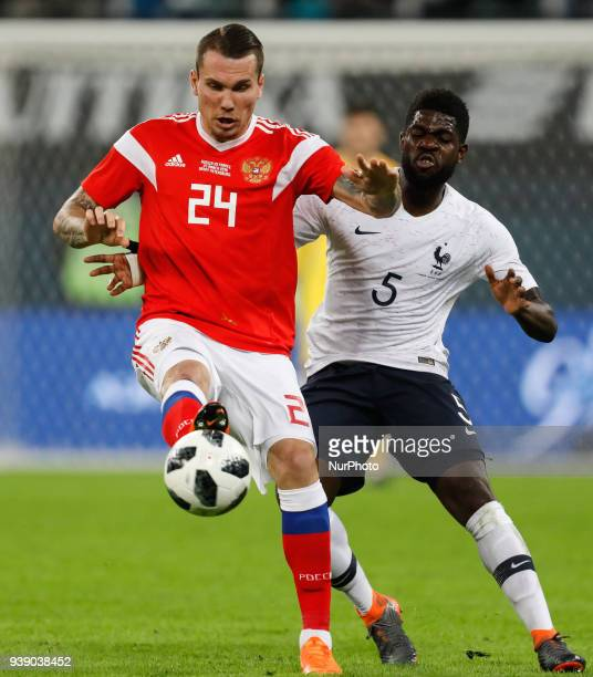 Anton Zabolotny of Russia national team and Samuel Umtiti of France national team vie for the ball during the international friendly football match...