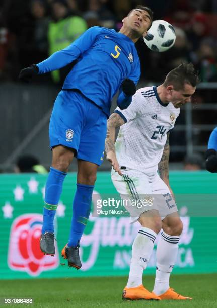 Anton Zabolotny of Russia vies for the ball with Casemiro of Brazil during the International friendly match between Russia and Brazil at Luzhniki...