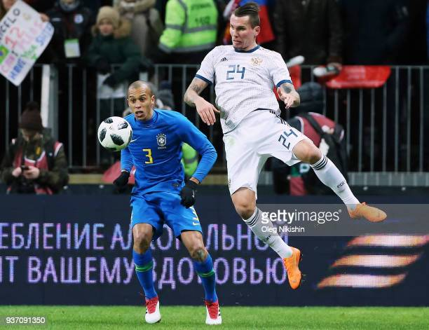 Anton Zabolotny of Russia vies for the ball with Miranda of Brazil during the International friendly match between Russia and Brazil at Luzhniki...