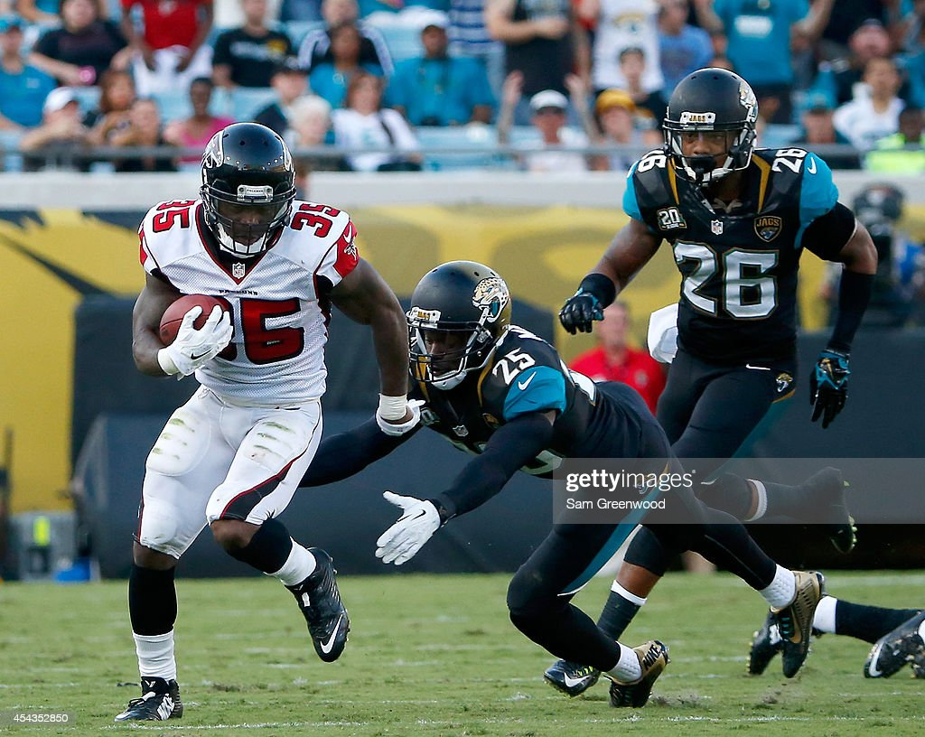 Antone Smith #35 of the Atlanta Falcons runs for yardage during the preseason NFL game against the Jacksonville Jaguars at EverBank Field on August 28, 2014 in Jacksonville, Florida.
