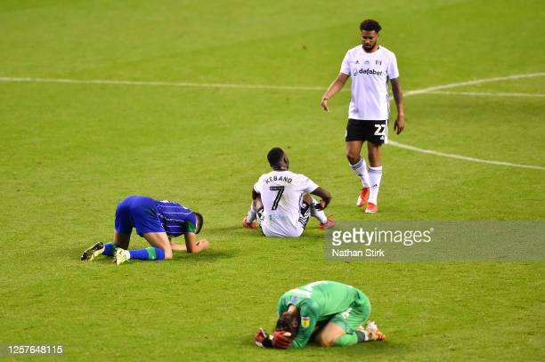 Antonee Robinson and David Marshall of Wigan Athletic Neeskens Kebano and Cyrus Christie of Fulham react after the Sky Bet Championship match between...