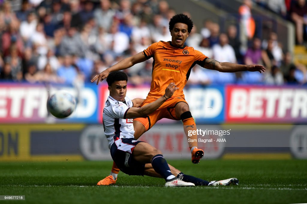 Antonee Robinson of Bolton Wanderers and Helder Costa of Wolverhampton Wanderers during the Sky Bet Championship match between Bolton Wanderers and Wolverhampton Wanderers at Macron Stadium on April 21, 2018 in Bolton, England.