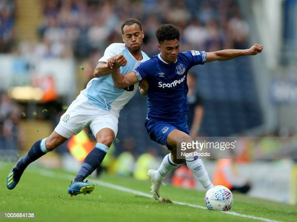 Antonee Robinson of Everton challenged by Elliott Bennett of Blackburn Rovers during the PreSeason Friendly match between Blackburn Rovers and...