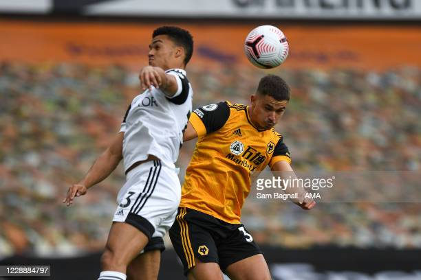 Antonee Robinson of Fulham and Leander Dendoncker of Wolverhampton Wanderers during the Premier League match between Wolverhampton Wanderers and...