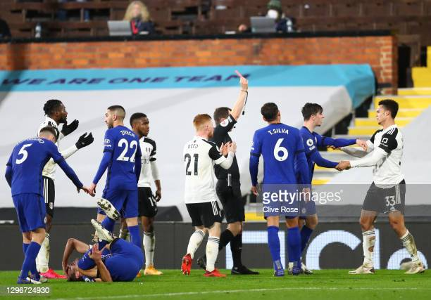 Antonee Robinson of Fulham is shown a red card and sent off by referee Peter Bankes after a foul on Cesar Azpilicueta of Chelsea during the Premier...