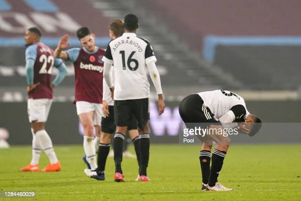 Antonee Robinson of Fulham reacts following his sides defeat in the Premier League match between West Ham United and Fulham at London Stadium on...