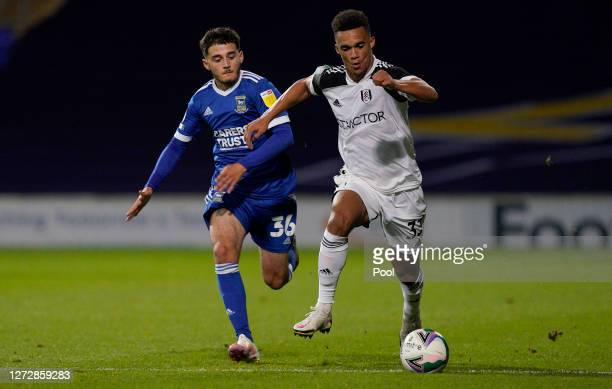 Antonee Robinson of Fulham runs with the ball under pressure from Armando Dobra of Ipswich Town during the Carabao Cup Second Round match between...