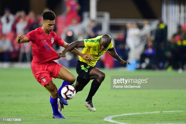 Antonee Robinson of the United States and Dever Orgill of Jamaica battle for the ball in the second half during an International Friendly at Audi...