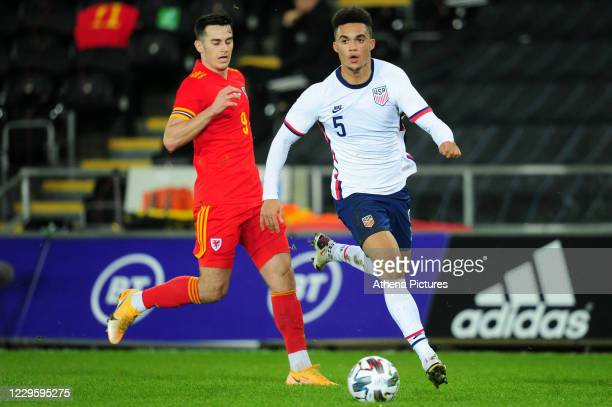 Antonee Robinson of USA in action during the international friendly match between Wales and USA at the Liberty Stadium on November 12 2020 in Swansea...