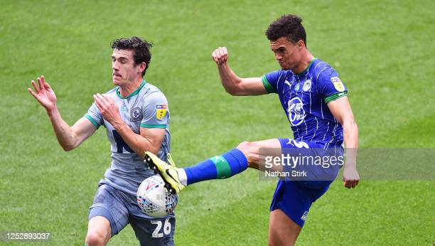 Antonee Robinson of Wigan Athletic and Darragh Lenihan of Blackburn Rovers challenge for the ball during the Sky Bet Championship match between Wigan...