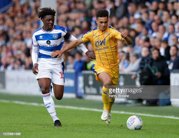 Antonee Robinson of Wigan Athletic and Ebere Eze of Queens Park Rangers during the Sky Bet Championship match between Queens Park Rangers and Wigan...