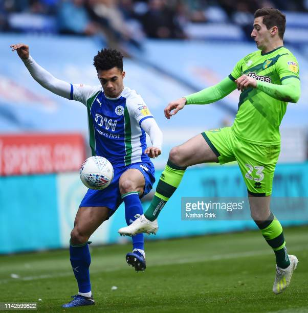 Antonee Robinson of Wigan Athletic and Kenny McLean of Norwich City battle for the ball during the Sky Bet Championship match between Wigan Athletic...