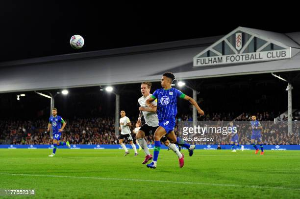 Antonee Robinson of Wigan Athletic and Stefan Johansen of Fulham chase the ball during the Sky Bet Championship match between Fulham and Wigan...