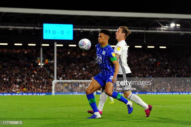 Antonee Robinson of Wigan Athletic battles for possession with Stefan Johansen of Fulham during the Sky Bet Championship match between Fulham and...